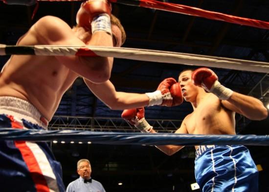 Antonio Maldonado (right) batters Justin Muse along the ropes