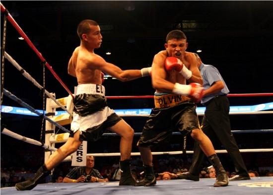 Estrada stings Mejia with a right uppercut