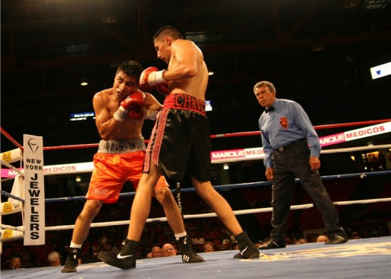 Sandoval (right) lands a short right to the jaw of Martinez