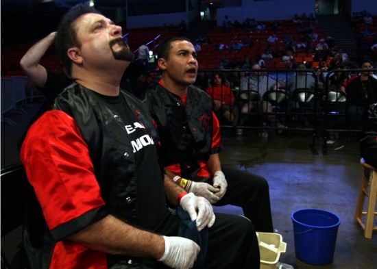 Colonna (left) and older brother Jesus Chavez exhort Sandoval from ringside