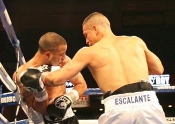 Escalante (right) takes it to Stark
