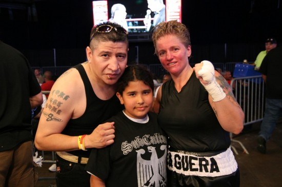 Rita Figueroa (right) with her manager, former boxer Rocky Martinez, and the daughter of a friend of Martinez's, after Figueroa's fight versus Tammie Johnson last Friday at the UIC Pavilion (photo by Juan C. Ayllon)