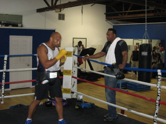 Former heavyweight contender Dannell Nicholson (right) looks on as Oquendo shadow boxes in the ring