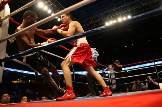 Ramiro Carrillo dumps Jamar Hampton into the corner (photo by Juan C. Ayllon).