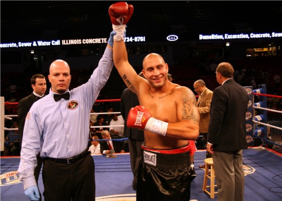 Referee Celestino Ruiz raises the hand of David Latoria, who at the request of his friend, Don George, smiles for my camera.