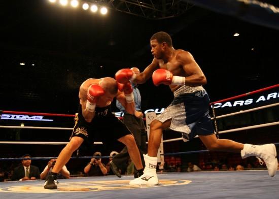 Gray (right) bounces a right off the top of Estrada's head.