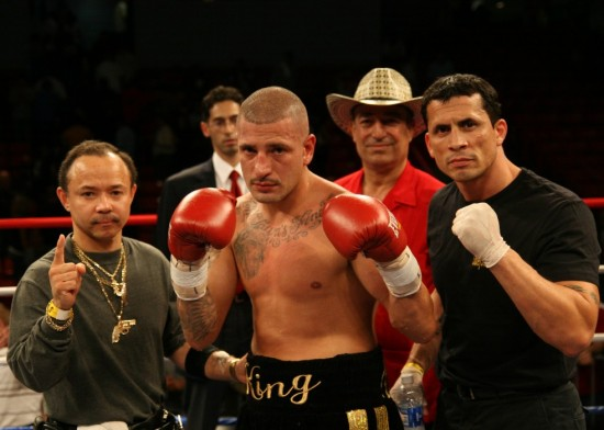 """David Estrada (center) with trainer, """"Fearless"""" Fernando Hernandez (right) and others."""