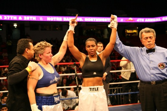Rita Figueroa (left) joins referee Genaro Rodriguez in raising Kita Watkins' hands in victory (photo by Juan C. Ayllon)
