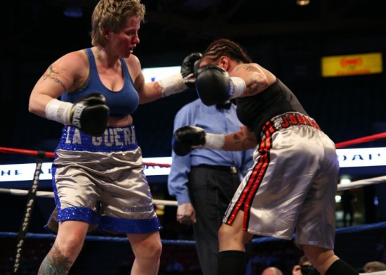Rita Figueroa (left) lands a jarring left hook to the face of  Tammie Johnson (photo by Juan C. Ayllon)