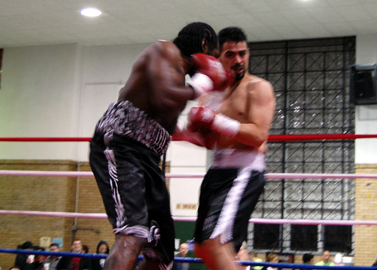 Pat Coleman and Rudy Cisneros exchange punches inside