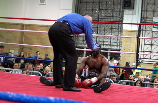 Referee John O'Brien counts over Coleman after a knockdown