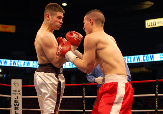 Bobby Jaskierny (L) sneaks in an uppercut on David Laque