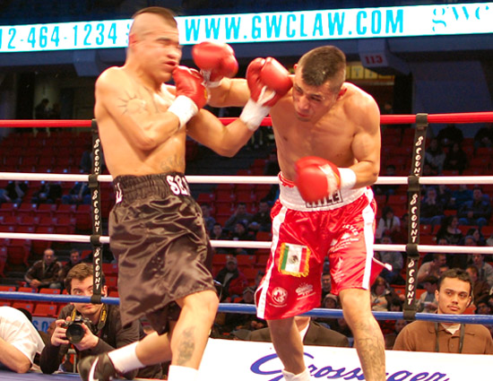 Montes de Oca (R) lands a hook as Cristobal comes in with an uppercut