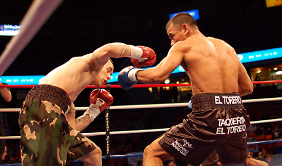 Antonio Avila (R) lands a hook under Herbert Acevedo's attack