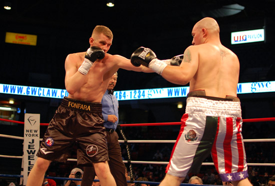 Fonfara (L) keeps Leal at bay with a jab