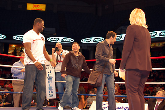 Alex Brown (L) and David Diaz joke as they enter the ring