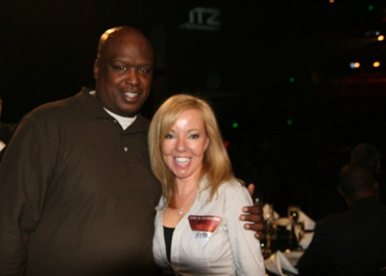 Guest of honor Buster Douglas, who knocked out Mike Tyson in arguably the boxing upset of the century, with my friend and assistant, Belle.