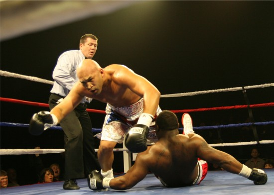 Oquendo (left) falls forward with King as he knocks him down with a smashing right to the chin.