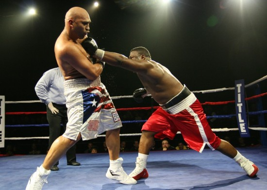 King (right) attacks Oquendo.