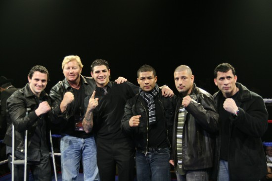 "Henry Coyle (far left), who couldn't fight as he injured his ankle in training, Donovan ""Da Bomb"" George (3rd from  left), Angel ""Torro"" Hernandez (3rd from right), ""King"" David Estrada (2nd from right), and ""Fearless"" Fernando Hernandez greet the crowd."