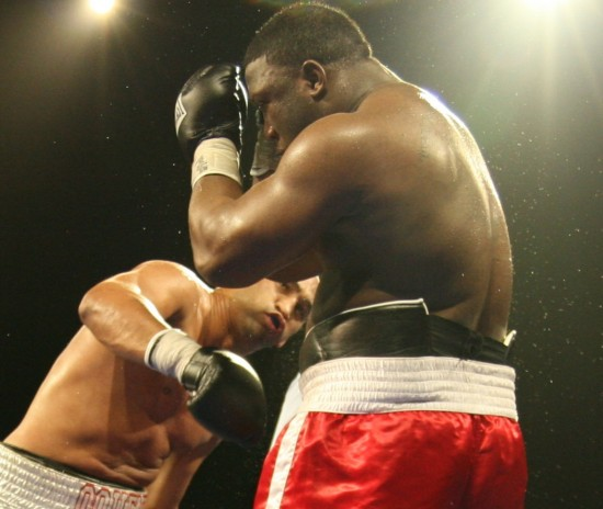 Fres Oquendo (left) sends spray flying from Demetrice King's head with a thudding right.