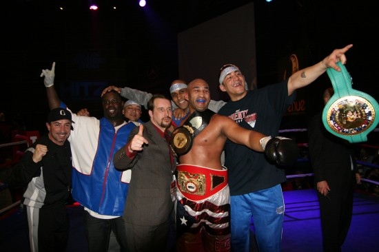 Oquendo (center) and his team celebrate his win.