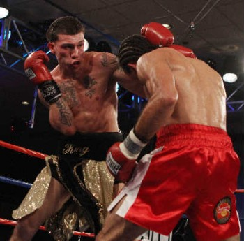 Gabriel Rosado (L) prepares to attack Saul Roman [Photo: Tom Briglia - Top Rank, copyright 2010]