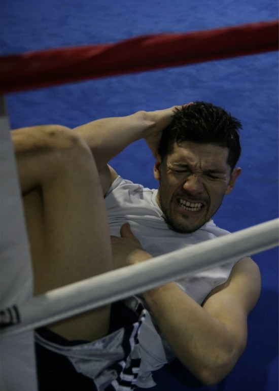 Diaz does some situps in a corner of the boxing ring.