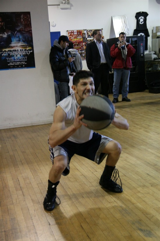 Diaz prepares to launch the medicine ball into another explosive toss.