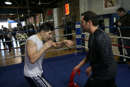 Diaz (left) does a shadow boxing drill with trainer Mike Garcia, who uses a knotted towel to hone his sharpness.