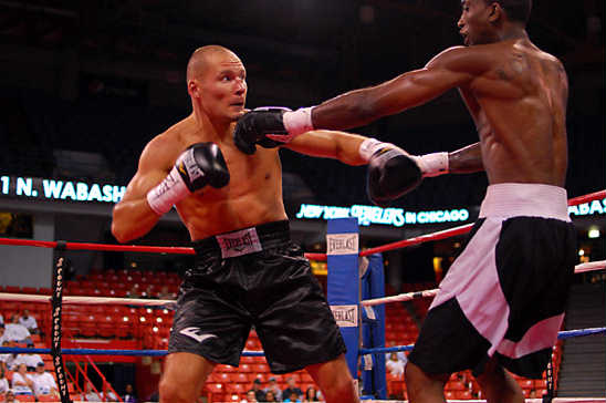 Donatas Bondoravas (L) stands his ground against Keon Johnson
