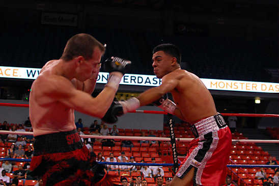 Adrian Grenados (R) attacks Michael Anthony Culbert in the fight of the night