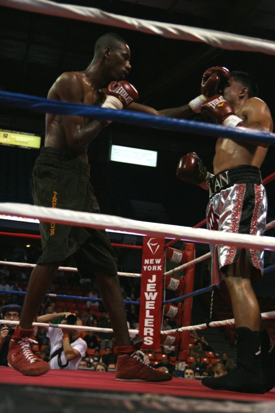 Titsworth (left) drives a left into the face of Granados.