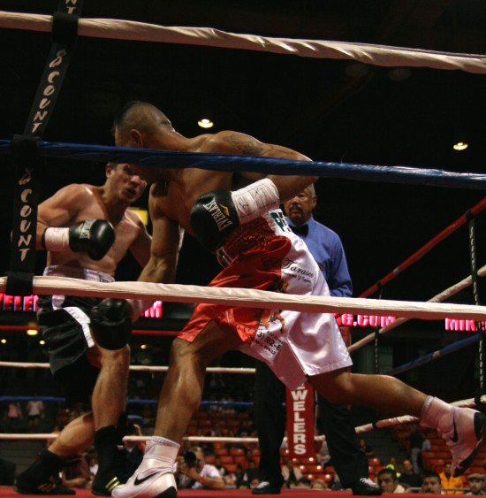 Perez (right) swings hard to free himself from the ropes.