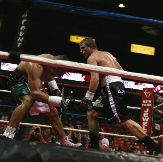 Novikov (right) batters Perez along the ropes.