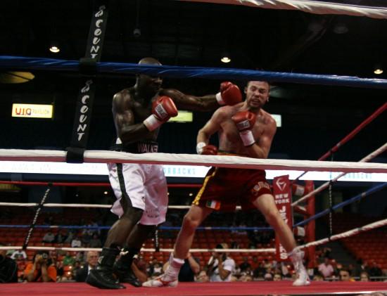 Walker (left) bounces a hook off the side of Lee's head.