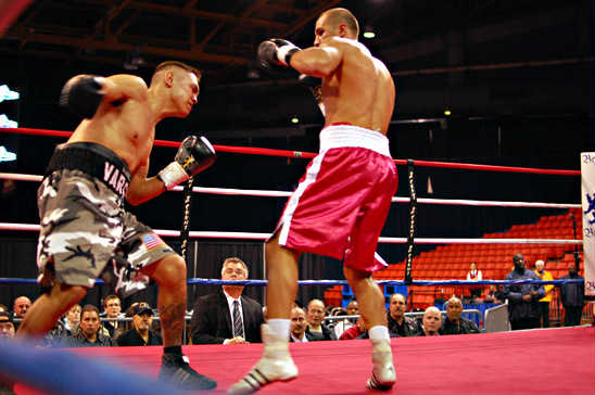 Dallas Vargas (L) leaves himself open for a counter from Sergey Kovalev