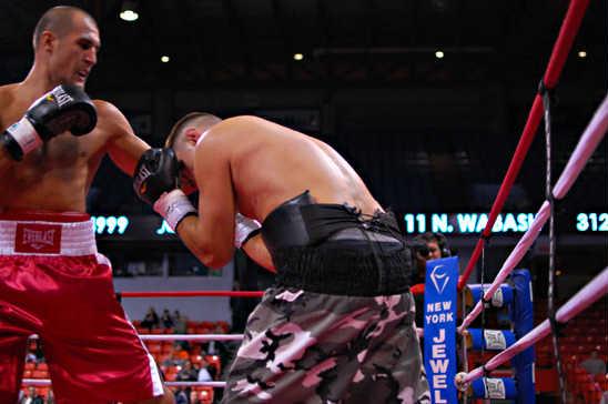 Kovalev (L) hooks his way to a TKO win over Dallas Vargas