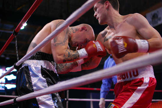 Ramiro Carrillo (R) traps Matt Ellis on the ropes on route to a first round TKO