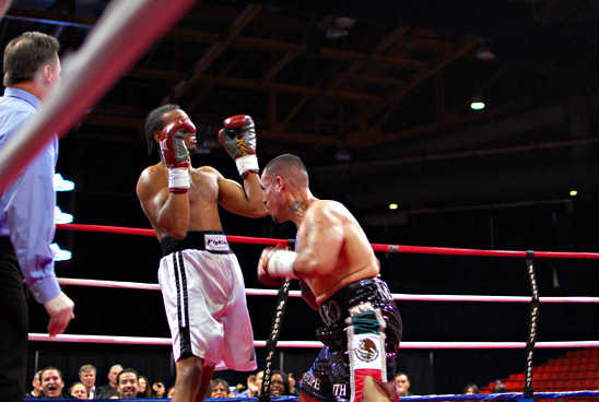 Mendez (R) rushes inside McPherson's reach to take the bout