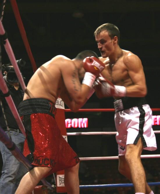 Gradovich (right) attacks Atencio along the ropes.