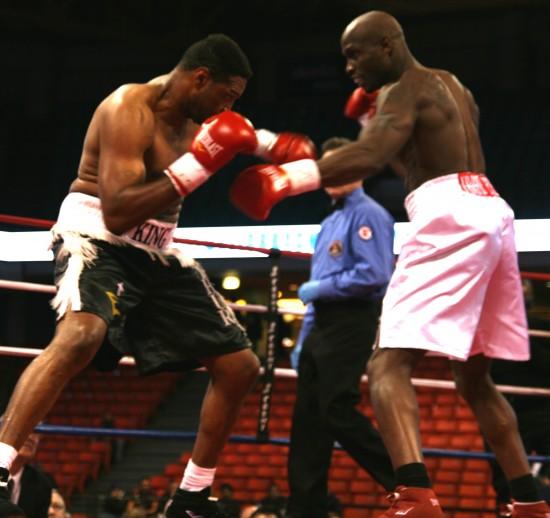 Davis (right) pumps a very stiff left jab to Williams' head.