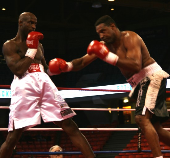 Davis (left) steps back from a Williams right to the body.