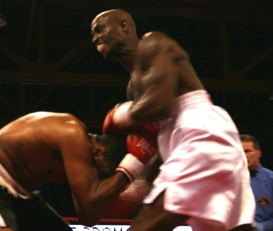 Davis (right) bombs with the uppercut as Williams covers up.