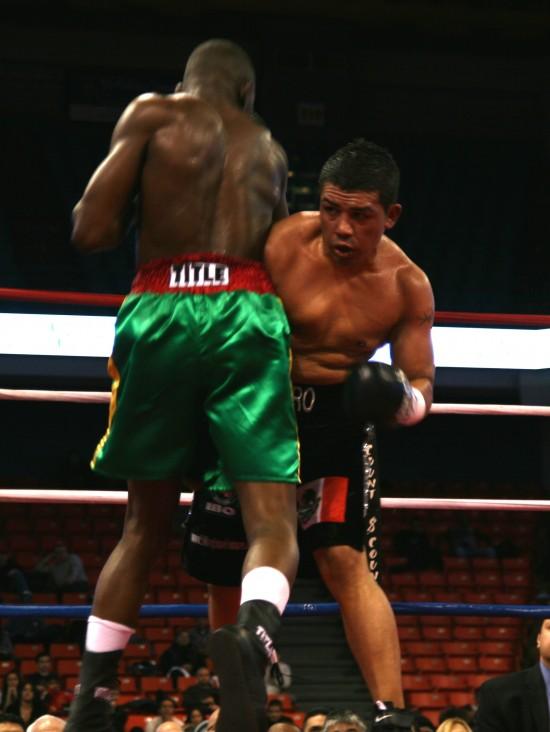 Adama (left) and Hernandez trade in close.