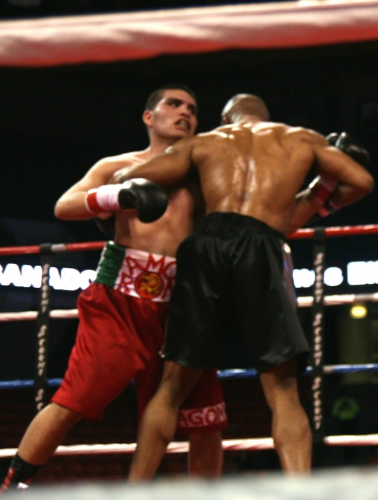 Valenzuela (left) and Choulute tangle up.