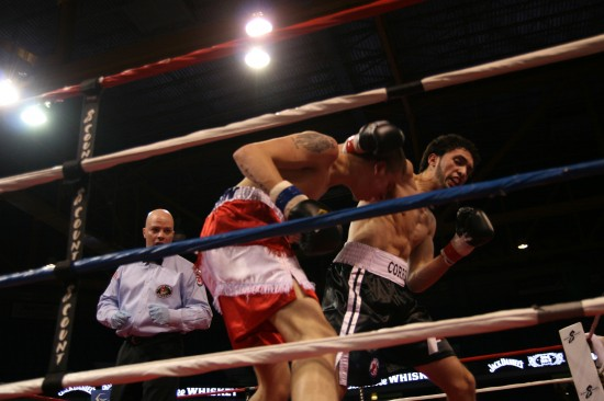 Correa (right) and Linenfelser mix it up along the ropes as referee Celestino Ruiz looks on.