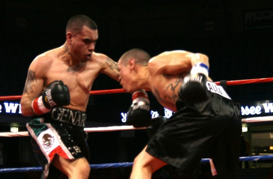Mendez (left) and Loya slug away at close quarters.