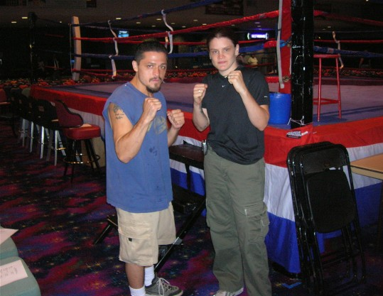 Molly McConnell, seen here with a fighter at ringside (photo courtesy Greg Beyer)