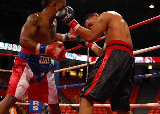 Rivera (L) and Bustamante exchange hooks